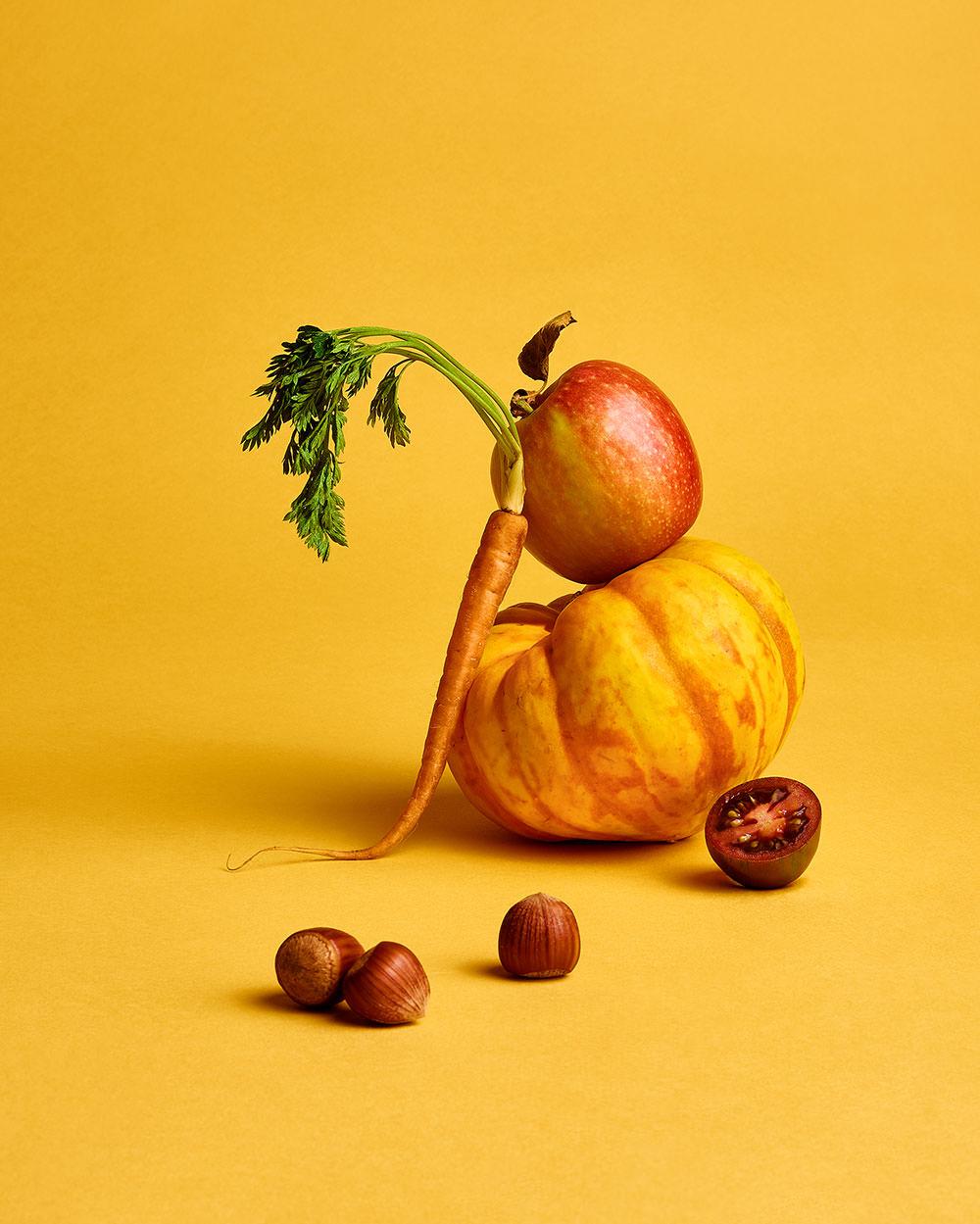 conceptual yellow mixed vegetable still life shot by camilo mateus