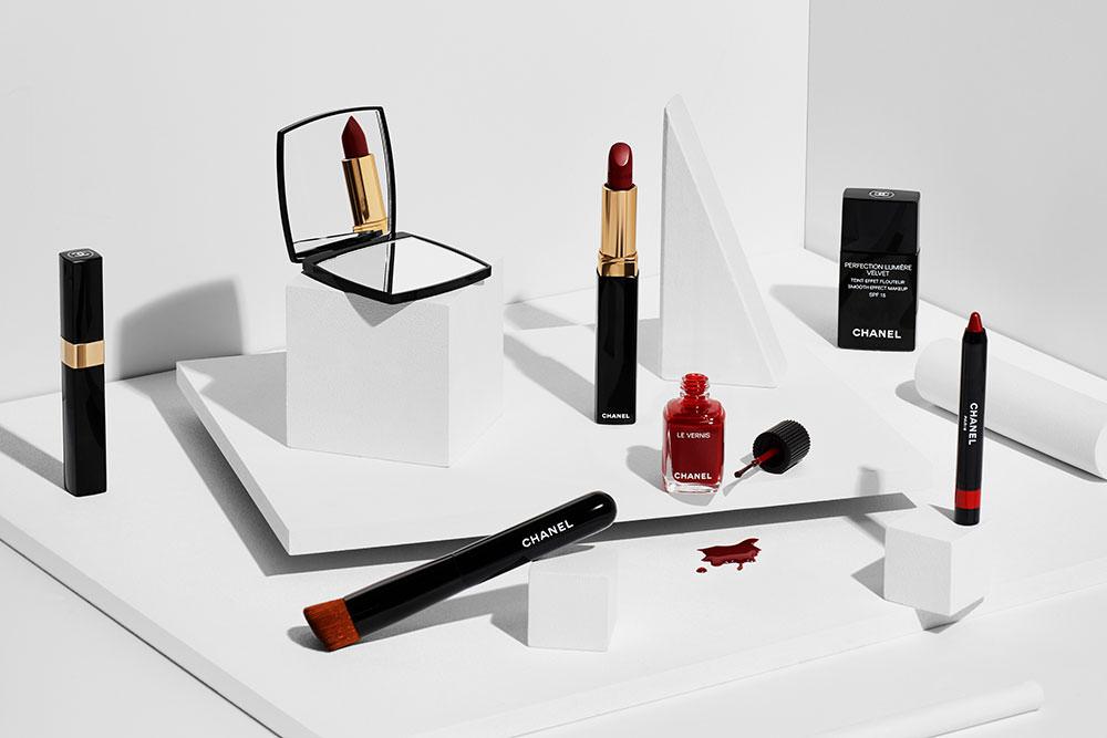 red chanel mixed cosmetics magazine still life by camilo mateus