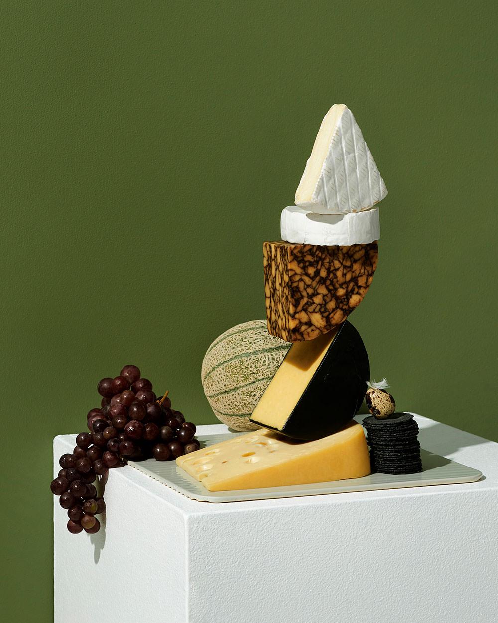 stacked cheese sculpture conceptual still life by camilo mateus