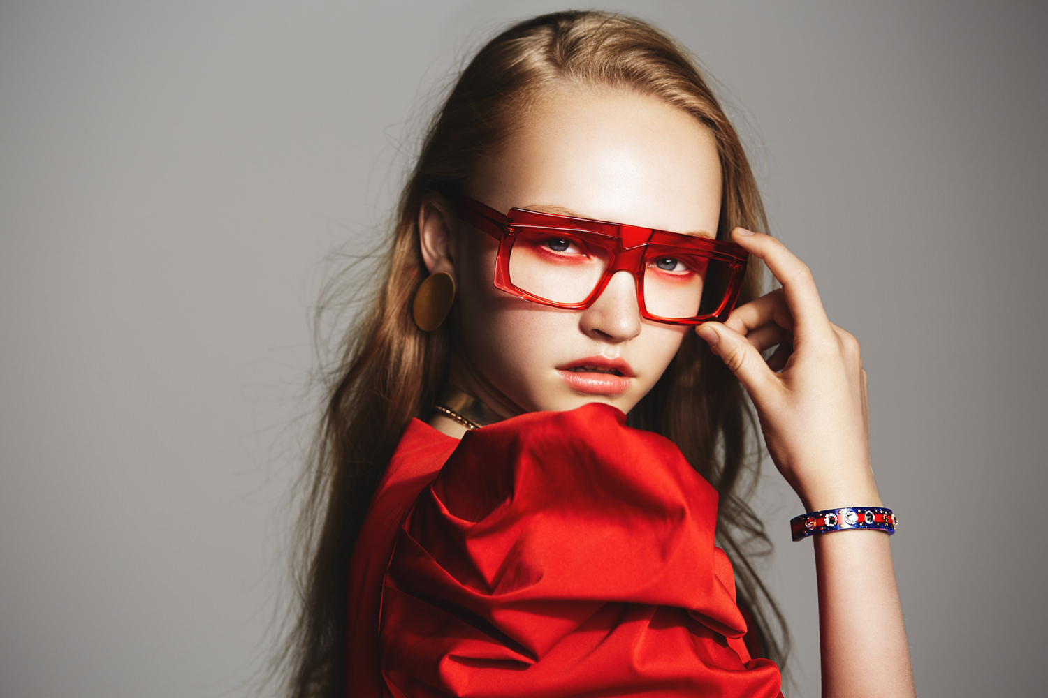 fashion editorial model wearing red outfit and red eyeshadow